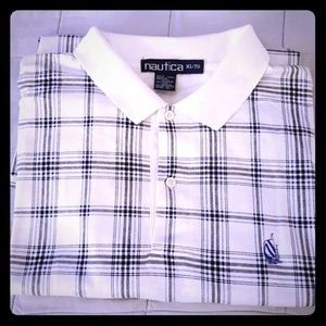 Men's white Nautica polo shirt.